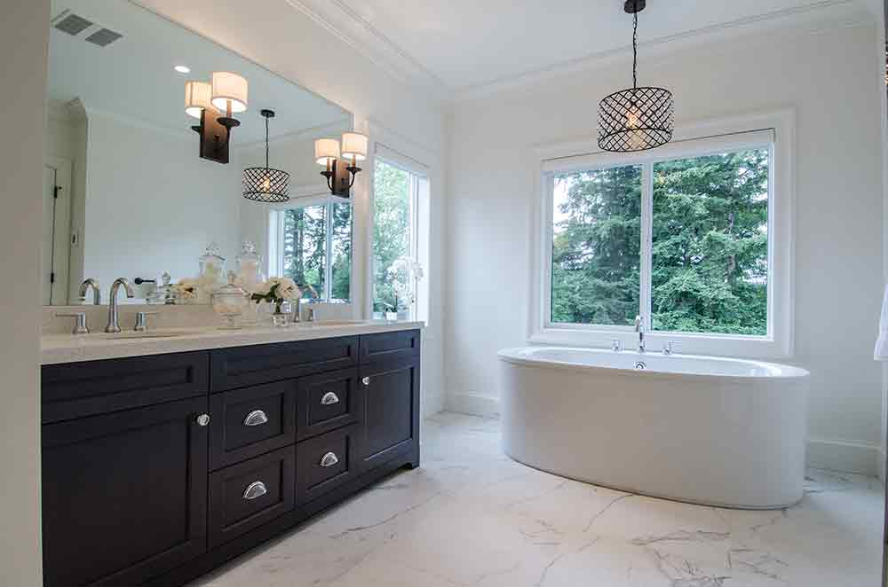 white bathroom with dark brown cabinets